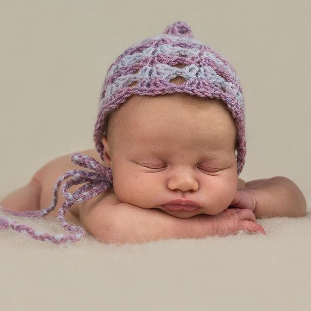 This little one looks so cute in one of our crochet bonnets.