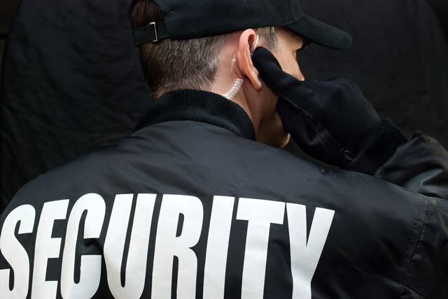 Security guard using RFID technology to manage an event