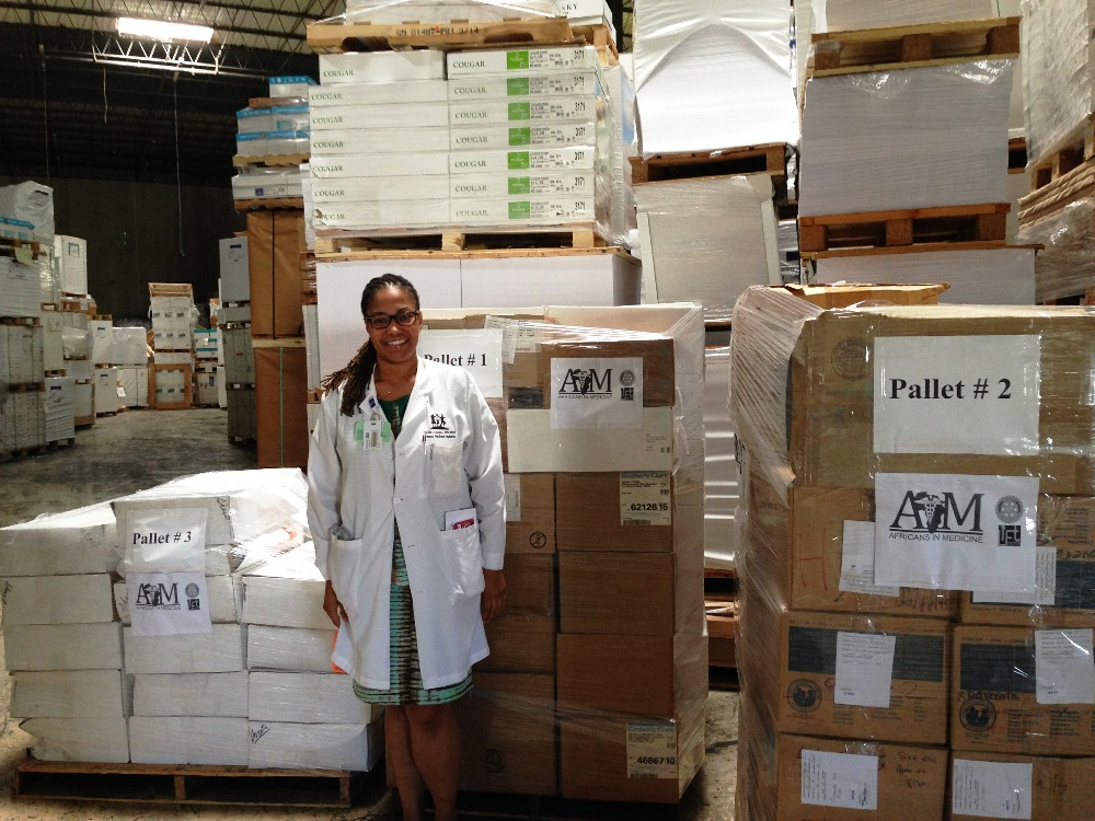 Nicole with AIM pallets for Liberia.jpg