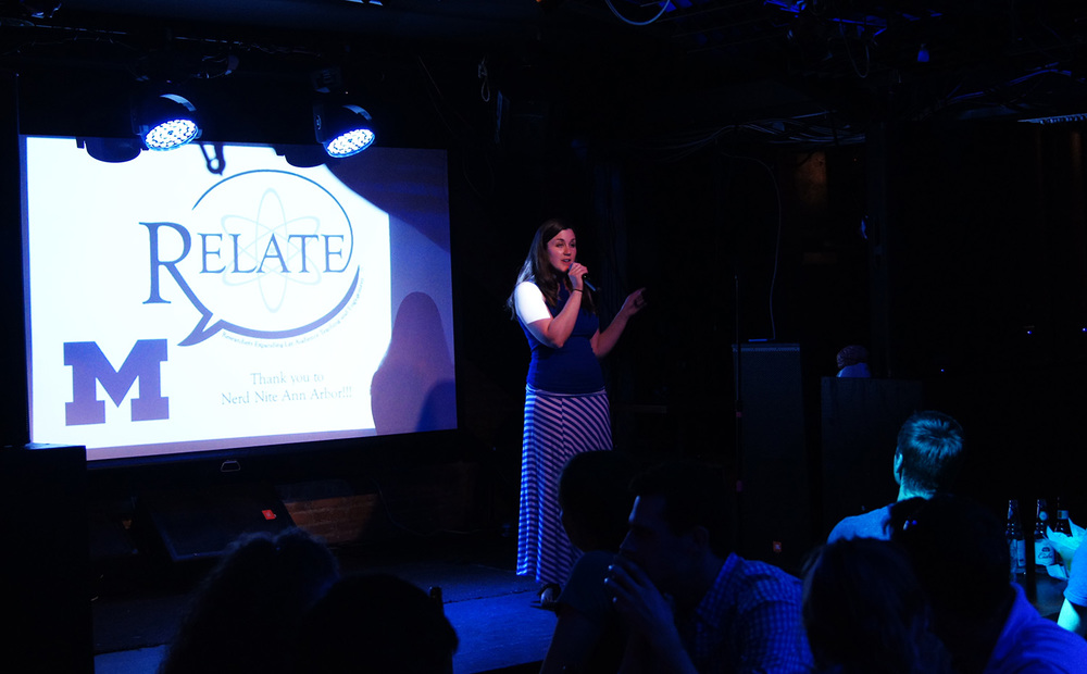 Me speaking on the Nerd Nite Ann Arbor stage, at an event co-sponsored by RELATE.