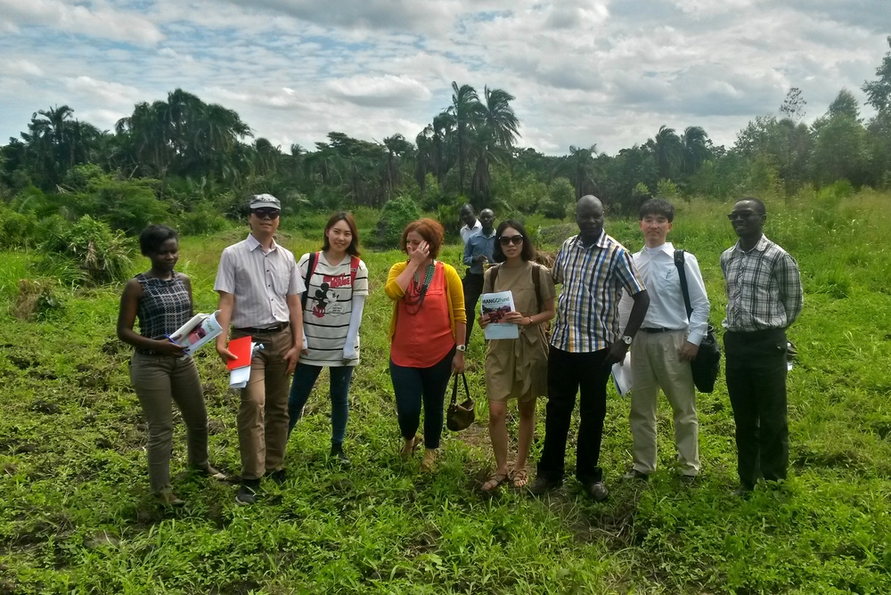 Sujin Kim, Hyun Sang Shin, Kim Jeongtae, Yeji Lee, Liz Lindow and Herbert Kisara with Moses Kairagura, the owner of Country Transporter who got financed an irrigation system for his farm.