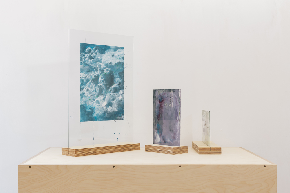P L I N T H S - Artist Tom Levy wanted to display his paintings on glass so that people could view both sides. We devised some simple laminated birch ply plinths with grooves to hold the pieces of glass.
