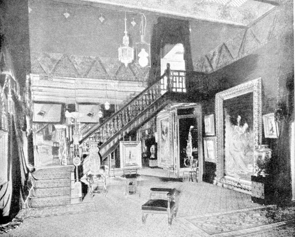 Grand Staircase of the Powers Art Gallery.  Le Cœur S'Éveille is the largest painting to the right of the staircase. Courtesy of the Rochester Public Library Local History Division.