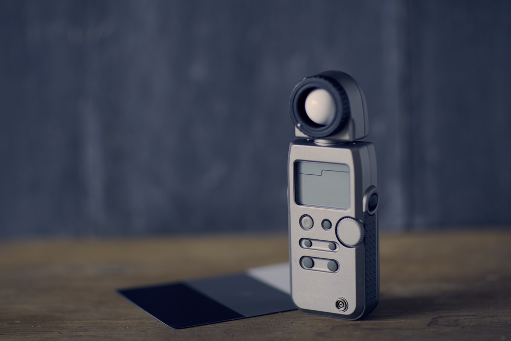 Sekonic L-358 Light meter + Grey card behind.