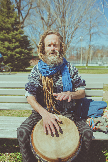 Haemish  on Flickr.  This is Haemish,   I met him the other day while biking (it was the first warm day in awhile) he was playing a Djembe in the beaches. I asked him if I could take a photo and he welcomed it. I ended up sitting and talking with him for about 20 minutes about life and travel and how we all oughta love eachother more. He is a really interesting dude.