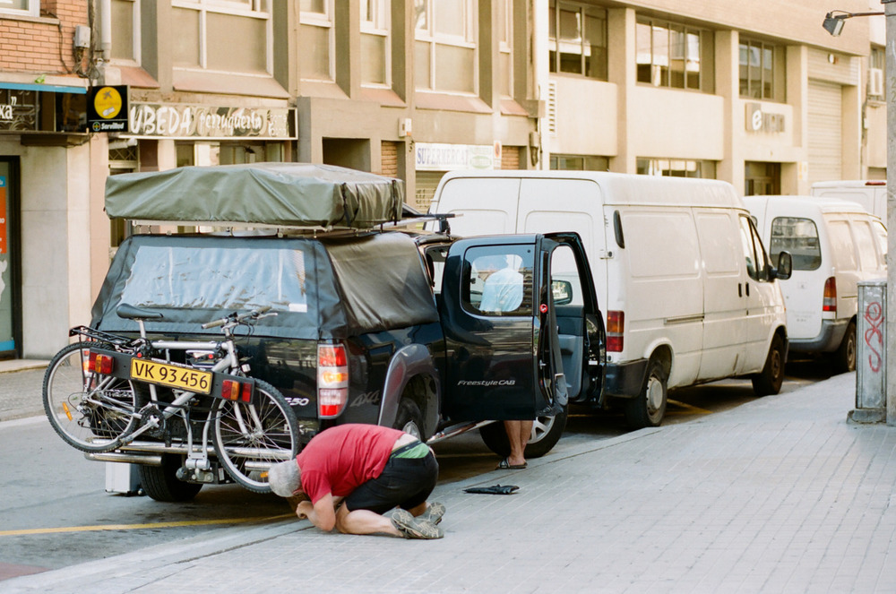 Spanish man fixes tire. -Zach EOS 5D mark II 85mm 1.8