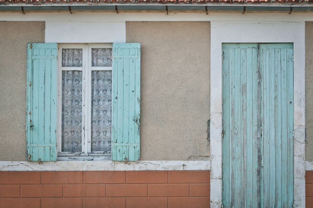 I really like all of the shutters and doors here. The pastel colours are just great. -Zach EOS 5D mark II 85mm 1.8