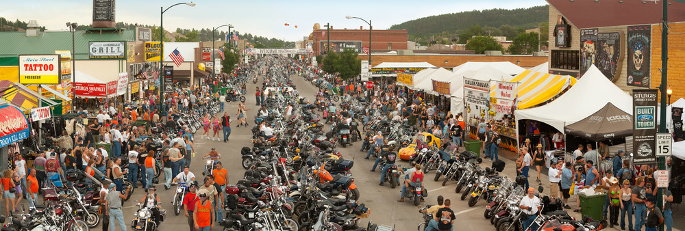 Motorcycle Rally; Sturgis, SD, 2005    Archival pigment print.    20 x 59 inches
