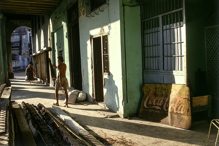 Arcade with Coca Cola Sign , Havana, Cuba, 1999  Archival pigment print.  13 3/8 x 20 inches
