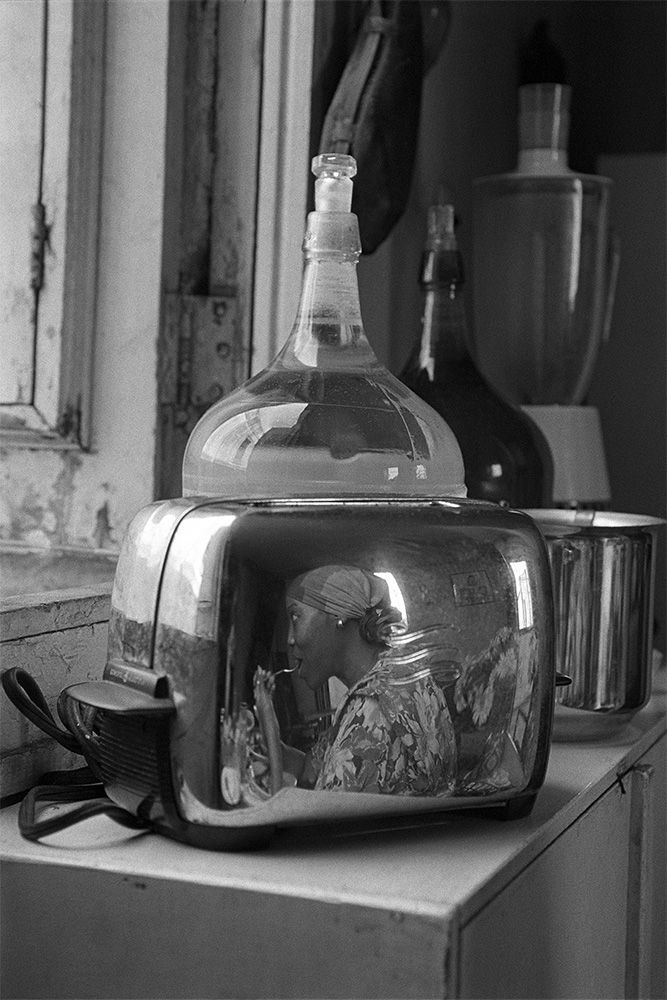 Mirtha on Toaster , Havana, Cuba, 2000  Archival pigment print.   20 x 13 3/8 inches