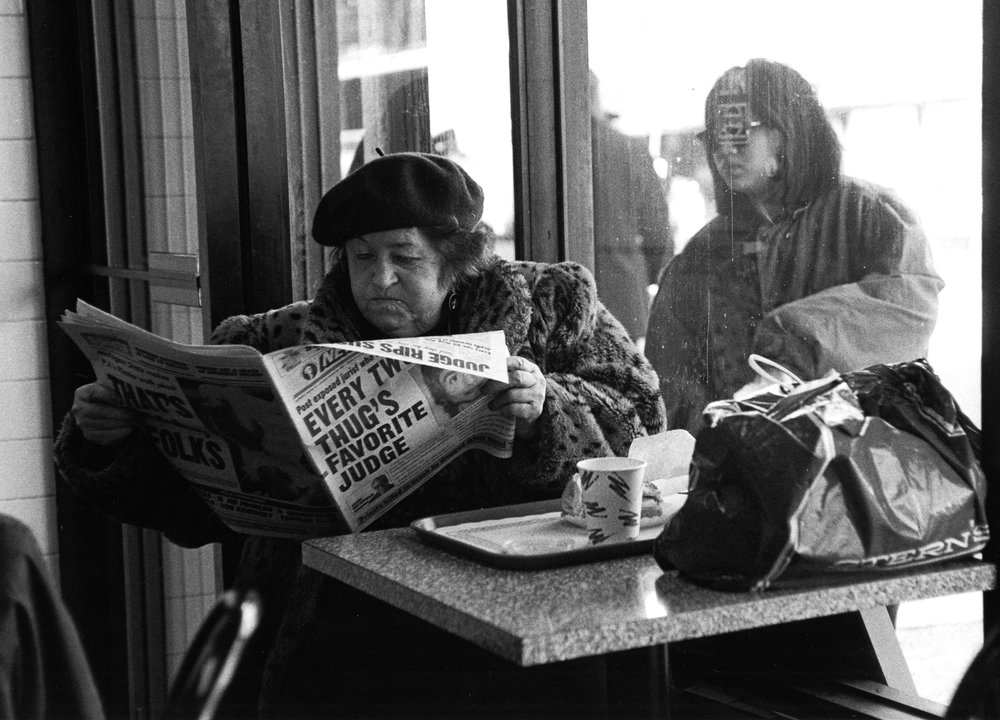 "Reading the New York Post , 1995  Archival Inkjet Print  20 x 13 3/8""  $800"