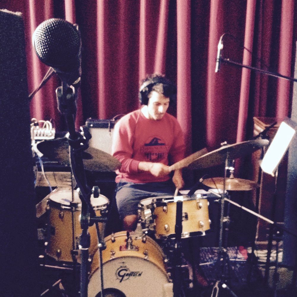 mike oliver laying drums on pain square.jpg