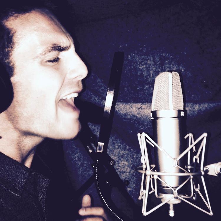 jake+recording+scratch+vocals+on+neumann+U87.jpg
