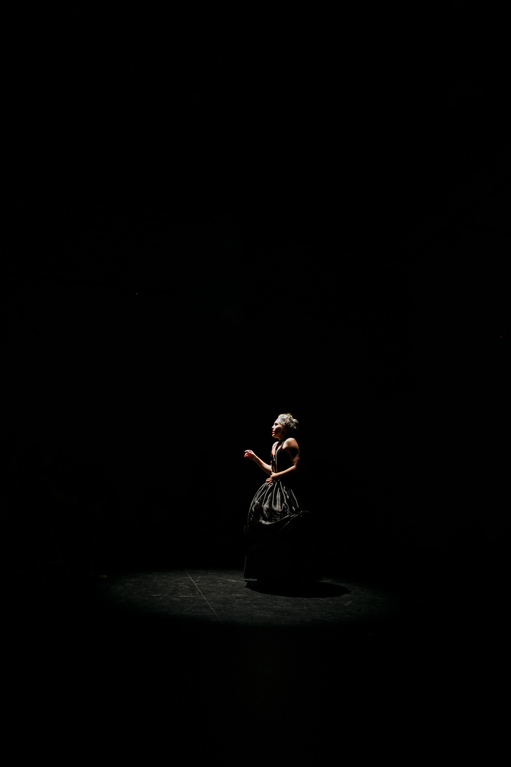 Lone actor onstage during NunaMaana immersive dance theater