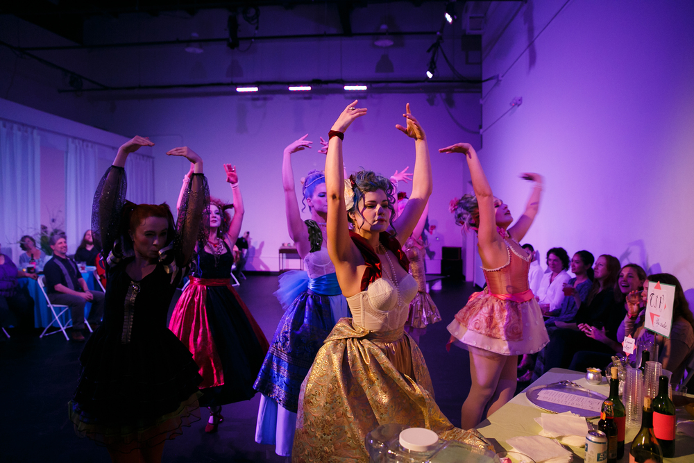 Group of dancers dressed in high fashion French gowns