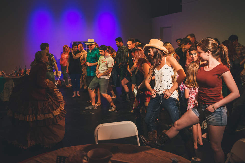 Audience members dancing during Wild West immersive theater show in Austin