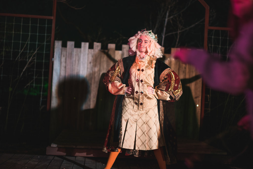 Renaissance king actor onstage at Austin event performance