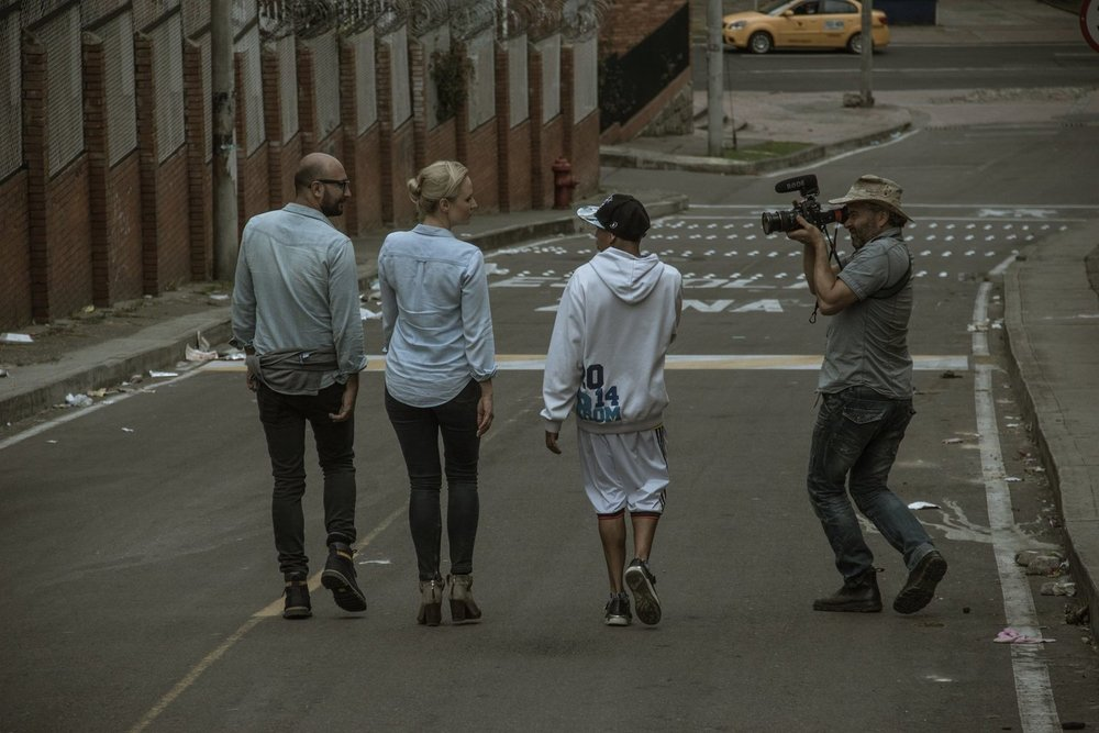 Interviewing a gang boss on the streets of Bogota, Colombia. Photo: WhereNext