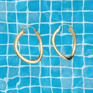 In other news: Loving all the new pieces by fave jewellery brand,  Tuza. These wavy hoops are perfect for the dog days of summer.