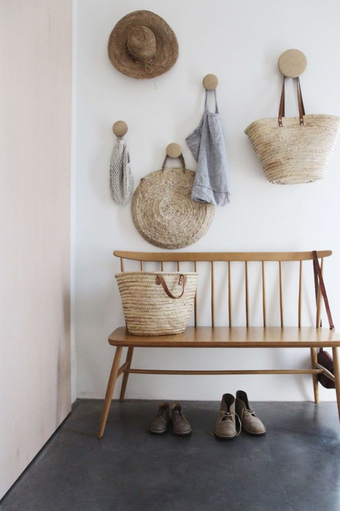 A basket and hat wall that guests could take for their day on the beach...