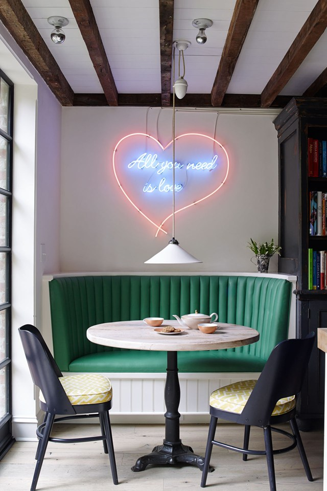 I've always loved neon signage and I feel like it's even lovelier when it's juxtaposed above the french bistro table and green banquet (link here).