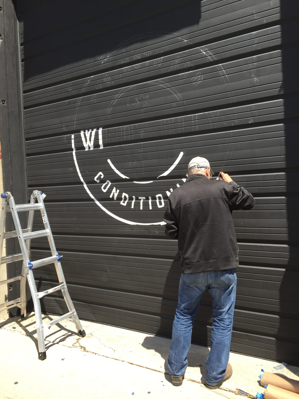 In-Progress Photo of The Custom Sign Painter Hard at Work