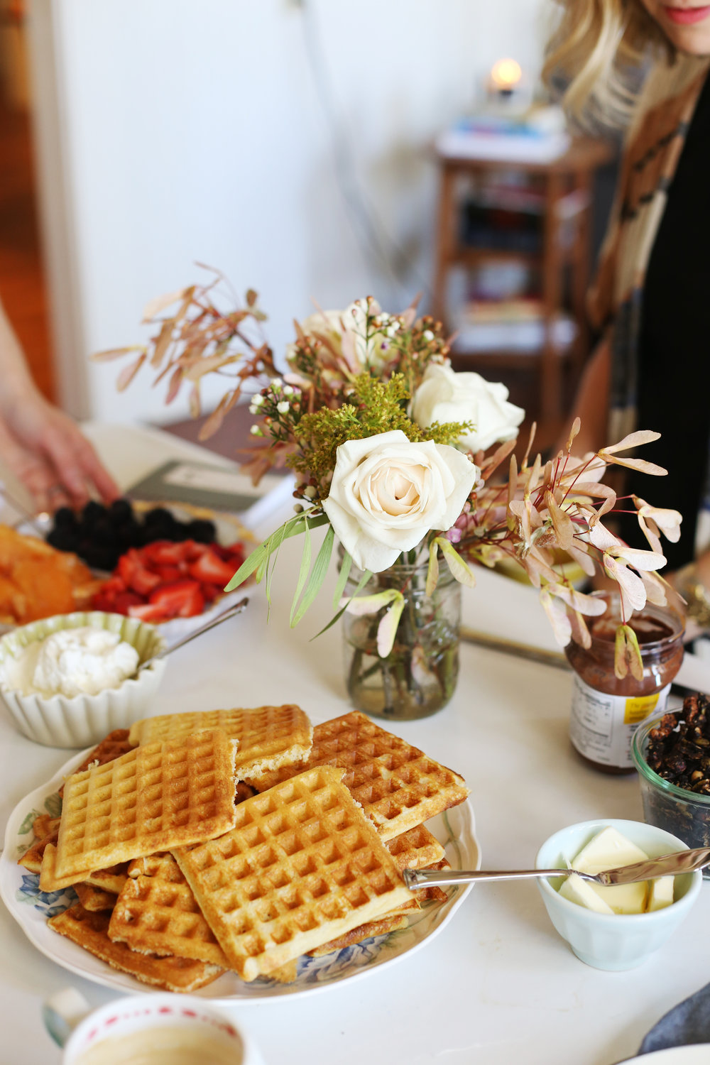 Our breakfast spread consisted of overnight yeasted waffles, fresh whipped cream, honey + cinnamon roasted grapefruit, fruit, Nutella and chocolate espresso granola. Thank you Mary for bringing the beautiful blooms!