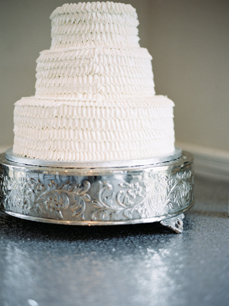 white-ruffled-wedding-cake-and-silver-cake-stand.jpg