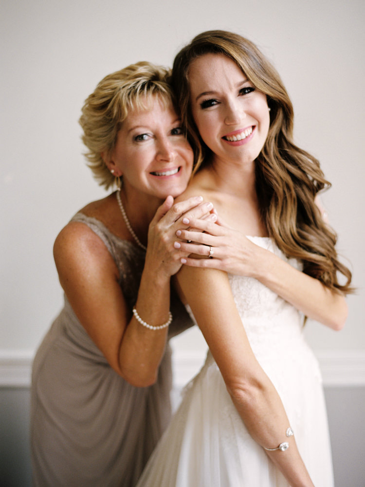 Bride-and-mother-hugging-and-smiling-jacksonville-florida.jpg