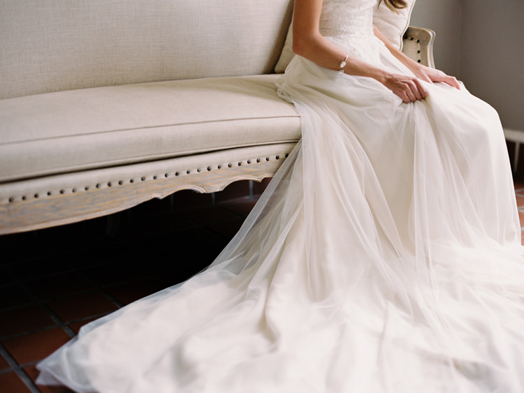 Bride-seated-in-flowing-tulle-wedding-gown.jpg