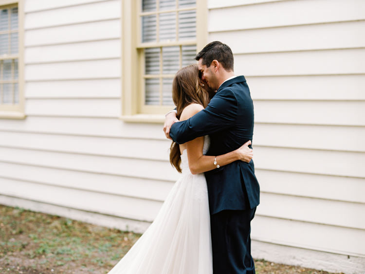 groom-and-bride-hugging-during-first-look-at-ribault-club.jpg