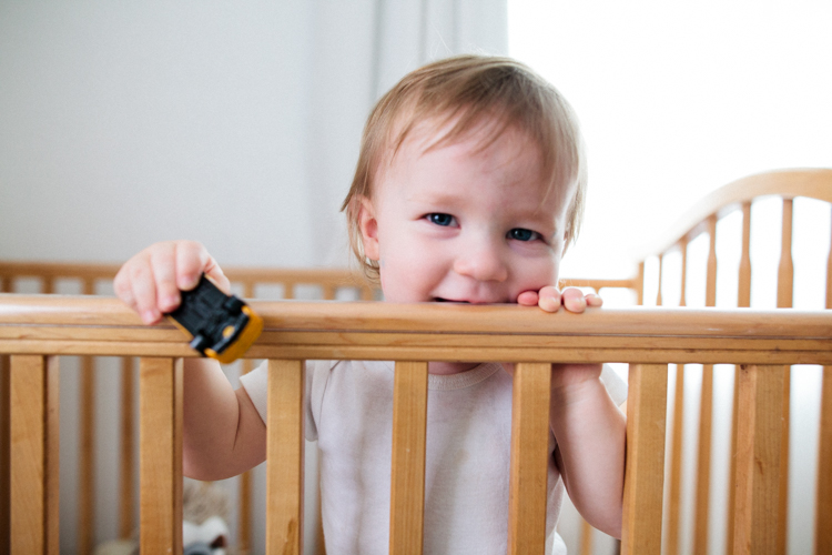 Baby-chewing-on-crib.jpg