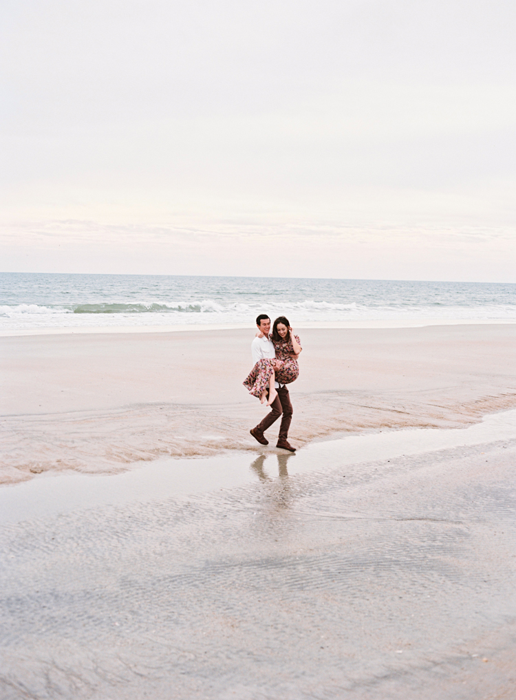 man-carrying-woman-over-water-jacksonville-beach.jpg