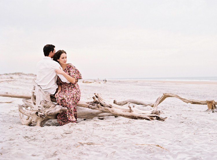 couple-sitting-on-driftwood-jacksonville.jpg