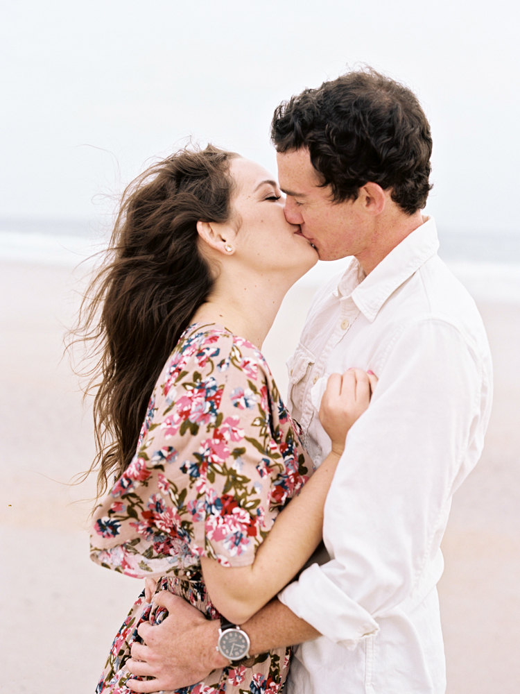 couple-kissing-at-little-talbot-park-beach.jpg