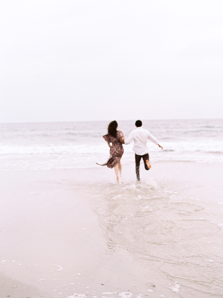 Couple-running-into-ocean-jacksonville.jpg