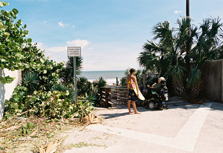 surfer-and-man-in-wheelchair-talking-ormond-beach.jpg