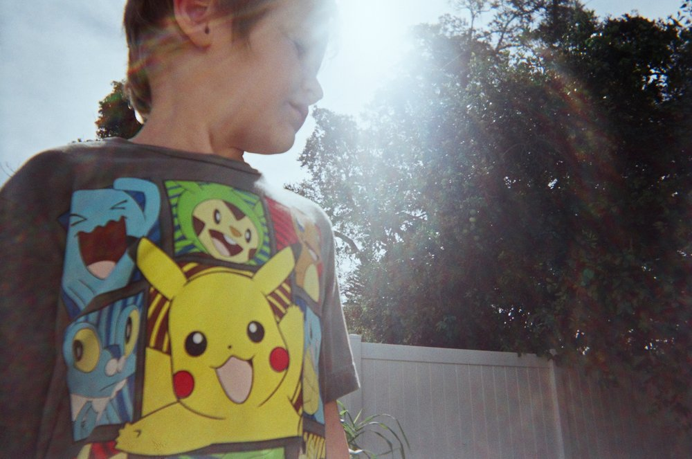 boy-in-pokemon-shirt-with-sun-beams.jpg
