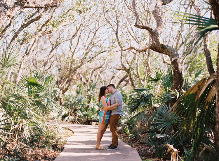 couple-kissing-in-the-woods-new-smyrna-beach.jpg