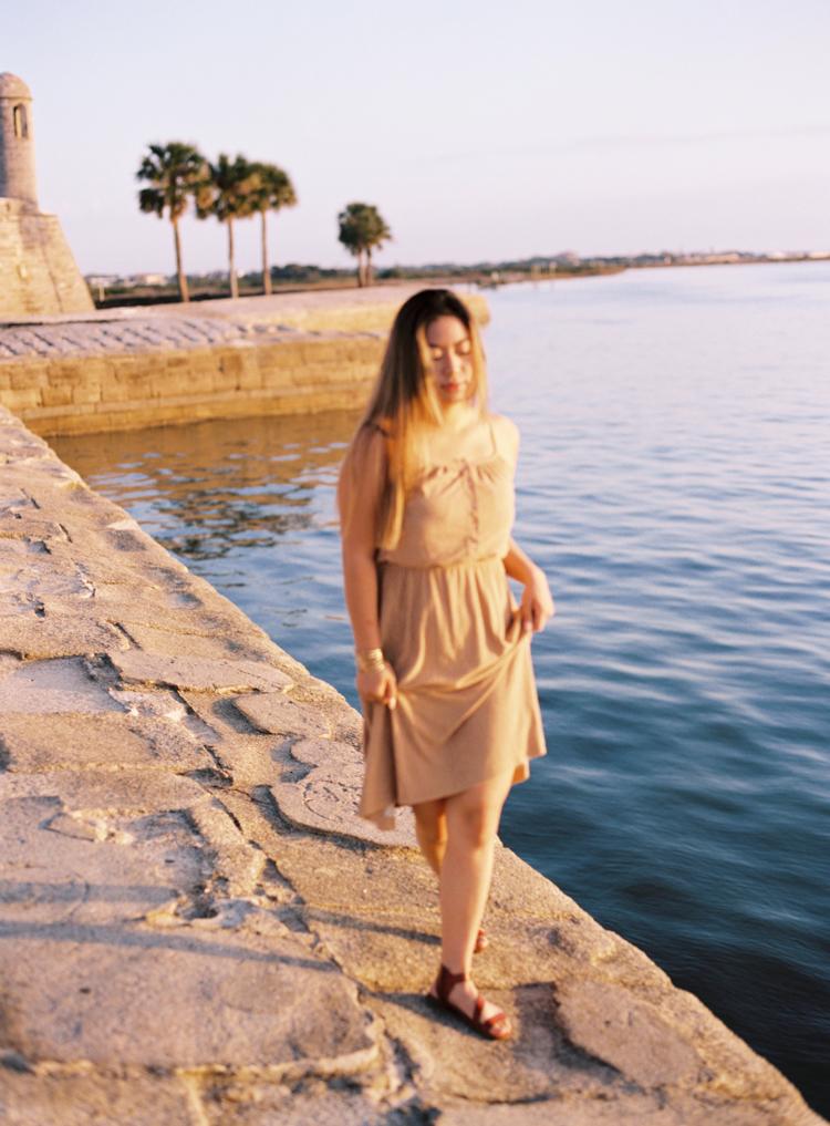 woman-walking-at-castillo-de-san-marcos-sunrise.jpg