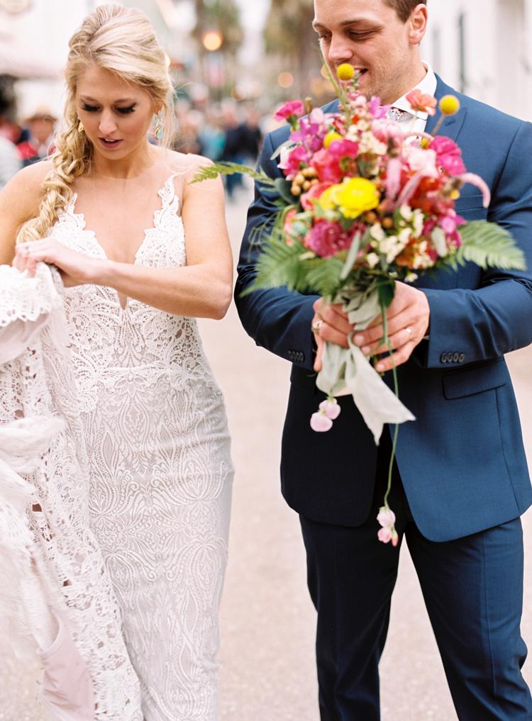 groom-helping-bride-with-flowers-st-augustine.jpg