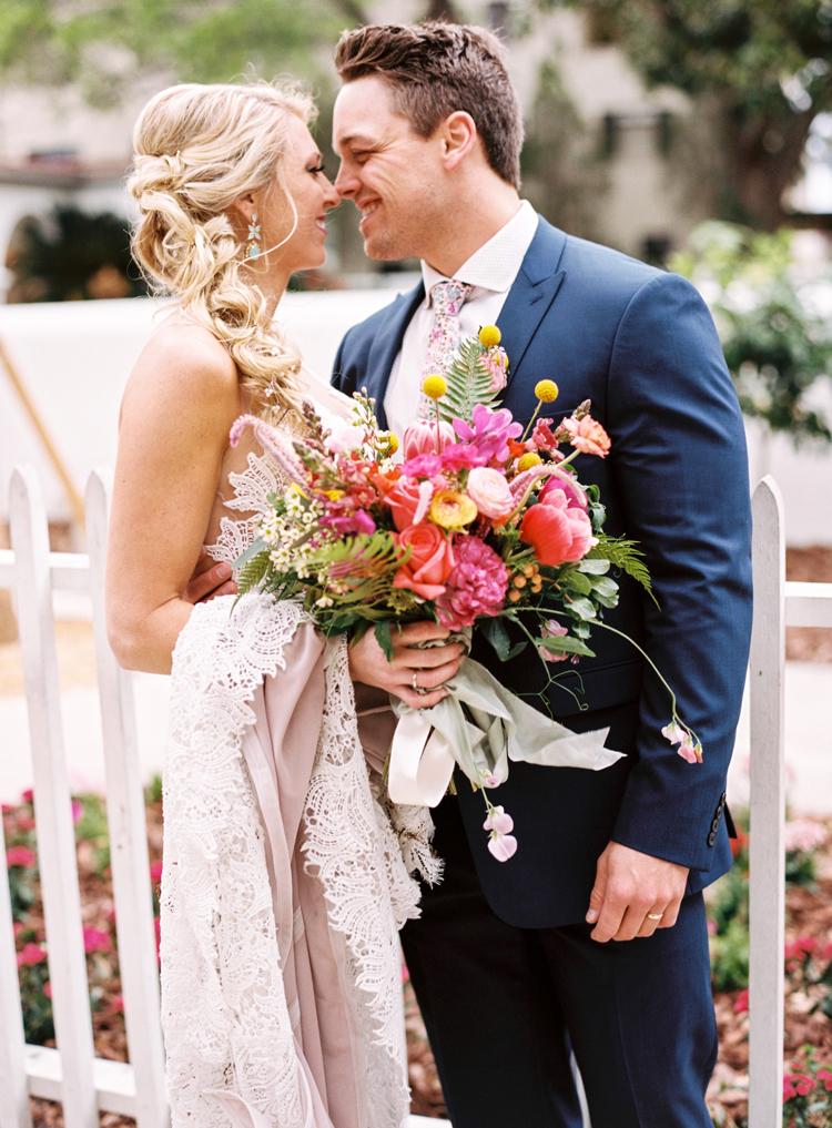happy-couple-bright-bouquet-blue-suit-st-augustine.jpg