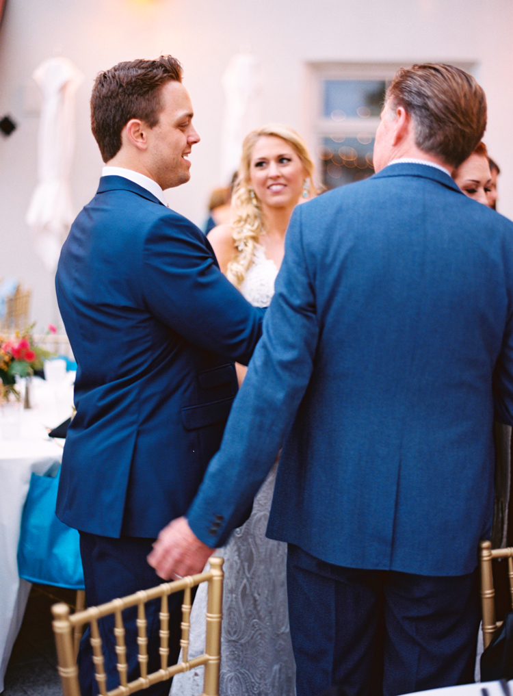 groom-and-bride-talking-with-wedding-guests-st-augustine.jpg