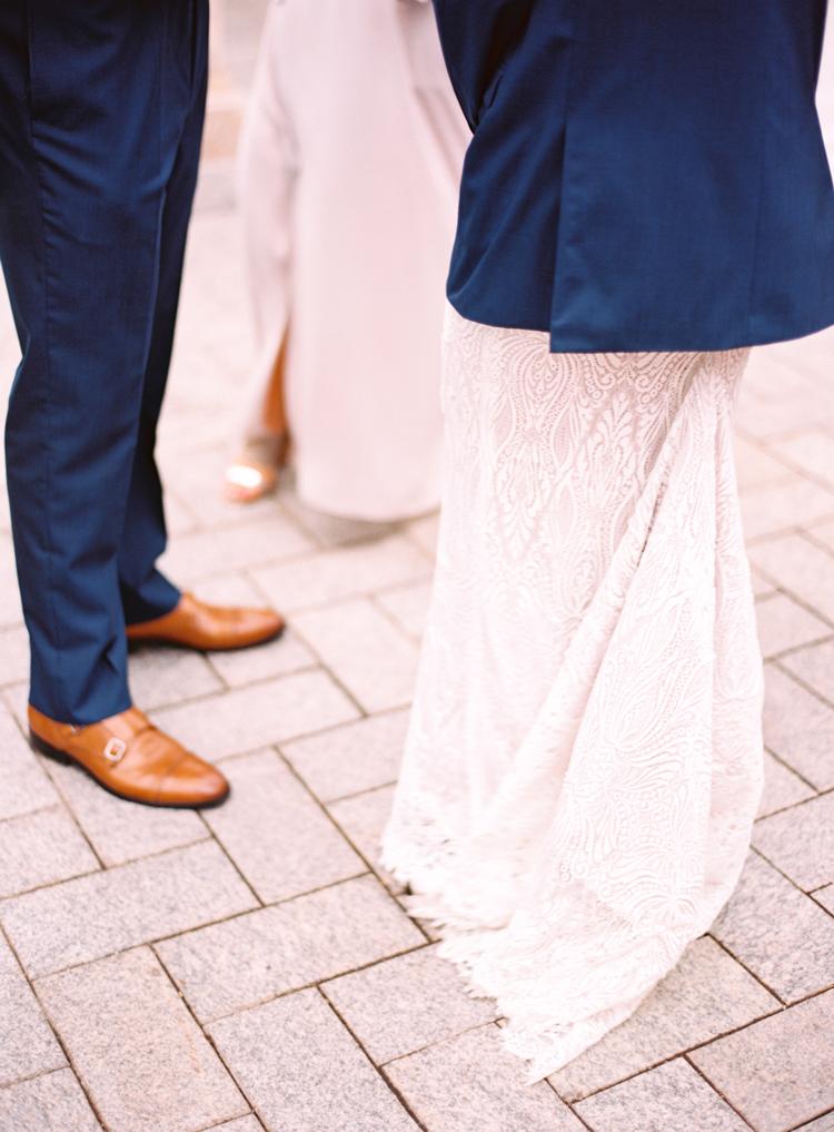 Bride-wearing-grooms-coat-st-augustine-wedding.jpg