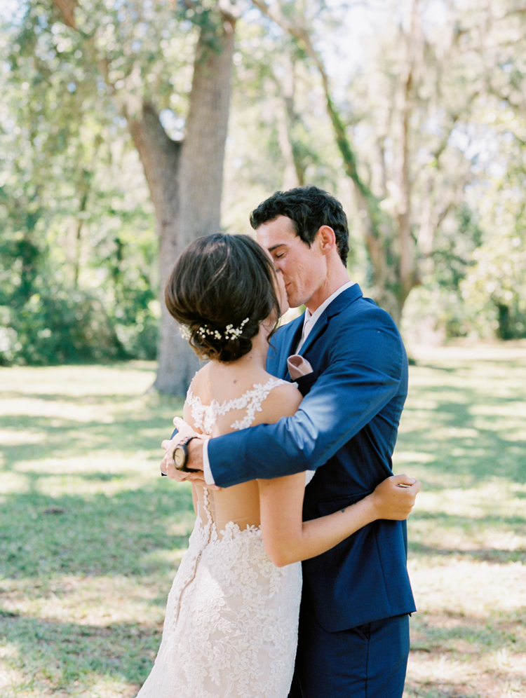 bride-and-groom-kissing-in-a-park.jpg