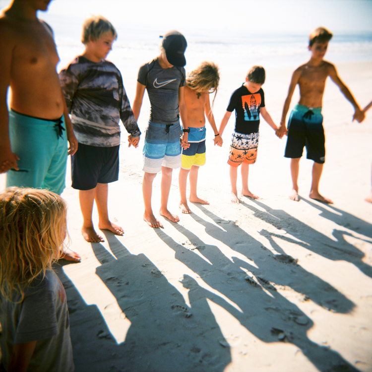 surfer-boys-praying-jacksonville-photographer.jpg