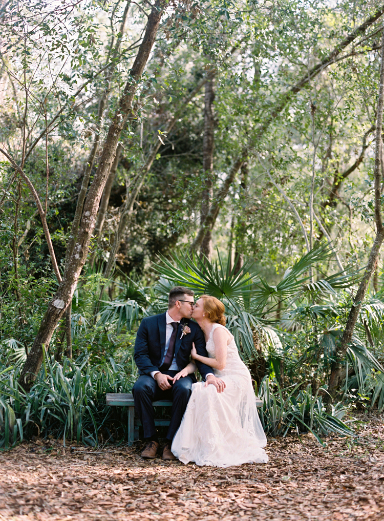 bride-and-groom-kissing-in-forest-bridle-oaks.jpg