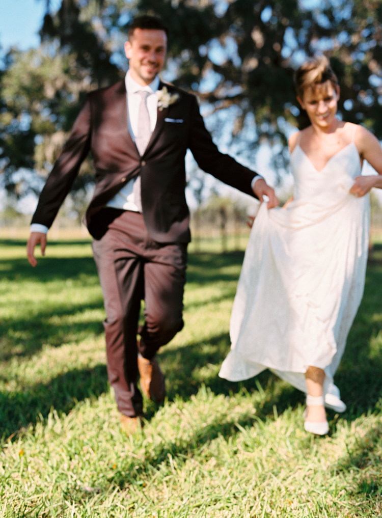 groom-and-bride-running-jacksonville-wedding.jpg