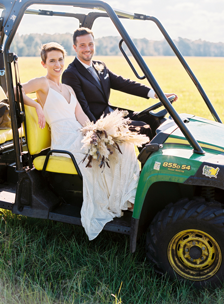 couple-in-tractor-at-florida-farm-wedding.jpg