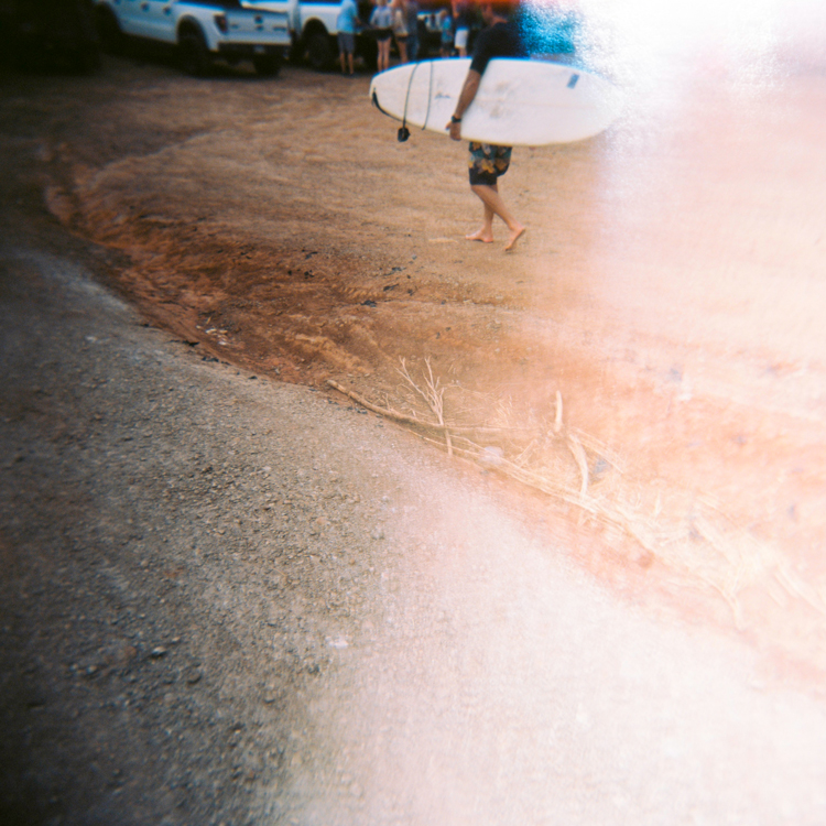 surfer-walking-on-red-maui-dirt.jpg